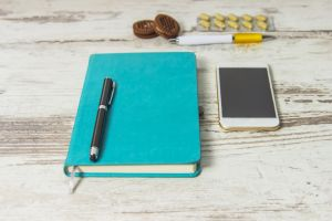 notebook–and-pen-for-coaching