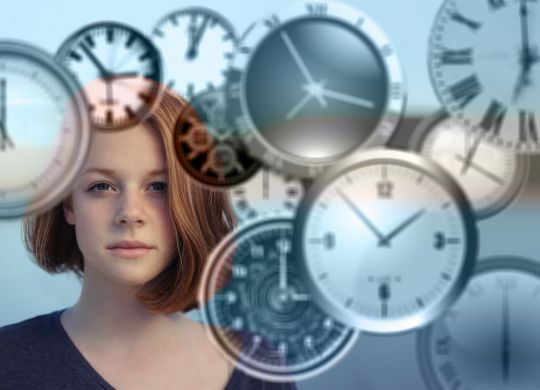 woman with clocks managing time
